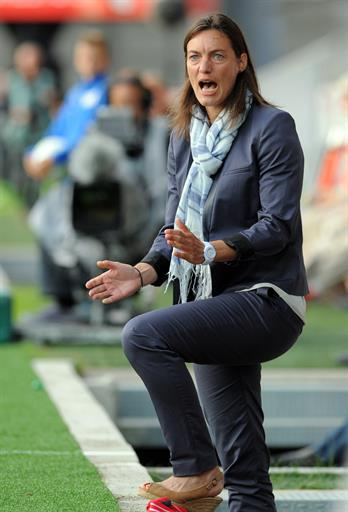 Clermont-Ferrand's French coach Corinne Diacre reacts during the French L2 football match between Brest and Clermont-Ferrand on August 4, 2014 at the Francis Le Ble stadium in Brest, western France. Diacre is the first woman to lead a men's professional team in a major European country. Diacre was hired after Clermont's original choice, another woman, Portuguese Helena Costa, resigned abruptly the day before taking charge of the team. AFP PHOTO / FRED TANNEAU